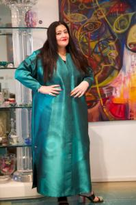 Artist Shalimar Sharbatly with one of her works