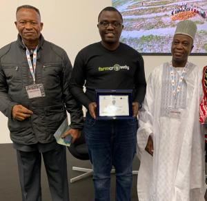 Farmcrowdy CEO, Onyeka Akumah displaying the UNIDO Disruptive Innovation Award flanked by the Nigerian Ambassador to the Vatican, Ambassador GG Umo and the Nigeria