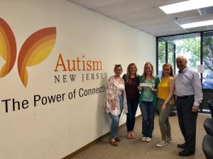 From the left, Montclair student Gabi Bartnik, Autism NJ; Jessica Barkosky, Director of Communication and Marketing; Suzanne Buchanan, Executive Director; MSU student Ally DeForge and PRSSA faculty adviser Larry Weiner