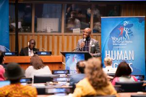 Rev. Ellis speaking at the United Nations about how he discovered the joy of helping others through the activism he did to earn his Human Rights Hero Award.