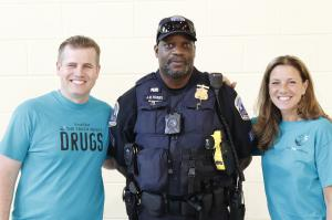 Drug Free World volunteers with Police Officer