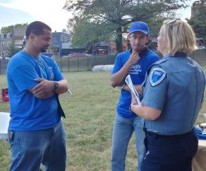 YHR DC Volunteers talking with police about human right education at National Night Out
