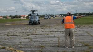The main airport in Freeport is closed due to flooding and damage but aid workers are deploying by helicopter.
