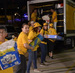 In Florida, Volunteer Ministers loaded a 16-foot truck with food and supplies and shipped it to the Bahamas by boat