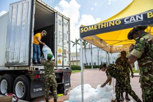 Scientology Volunteer Ministers help get food ready and loaded into trucks